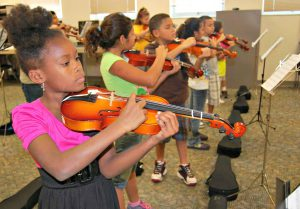 Students learn violin from A Gift For Music