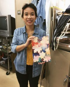 Alex Schouten pictured with her art created while at Crealde