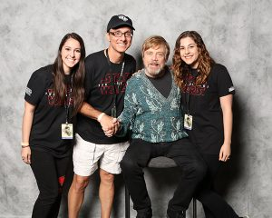Peter Telep (second from the left) posing with actor Mark Hamill at Star Wars Celebration 2017.
