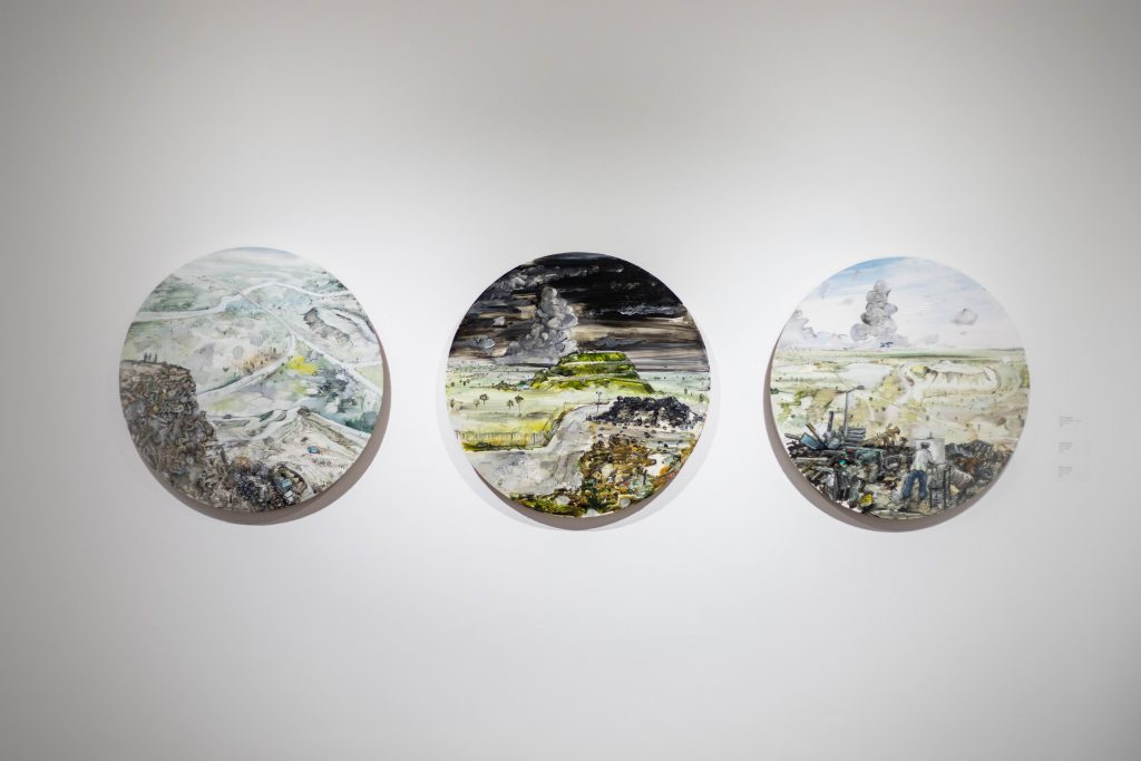 Amer Kobaslija's artwork in the 2018 Faculty Show. A tryptic of 3 circular paintings.
