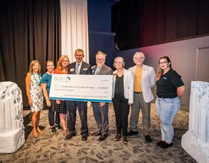 Reps from arts orgs receive funds from OSC. Photo by Roberto Gonzalez