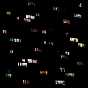 Photographic artwork created by Clarissa Bonet, this image shows a collection of illuminated windows at night.
