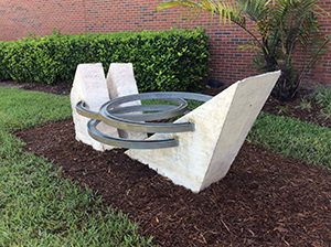 Public Art Sculpture located at UCF outside of the Visual Arts building. Cast concrete and aluminum from the 1970's.