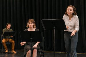 Students rehearse for a staged reading at Pegasus PlayLab