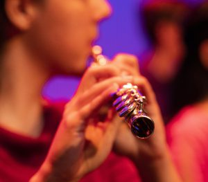 A flutist plays in the New Music Ensemble