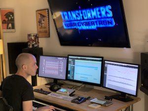 Alex Bornstein composing music on his computer