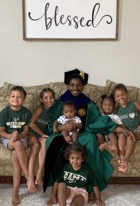 Dwight Lewis with his nieces and nephews