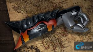 Orange and silver painted 3D prosthetic arm made in collaboration with Limbitless Solutions and Assassin's Creed Odyssey