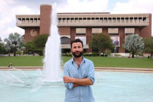 Haidar Khezri, UCF's first assistant professor of Arabic, in front of the Reflecting Pond