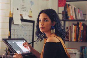 Vanessa Flores, Graphic Design Alumna, in her studio