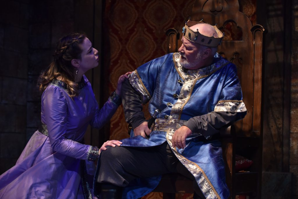 Mark Brotherton performs with a student in Lion in Winter dressed as a king.