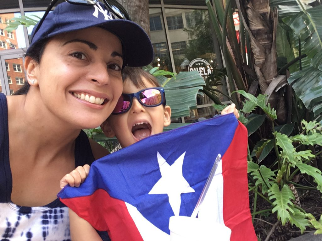 Stacey DiLiberto and her son celebrate at the Orlando Puerto Rican Day Parade